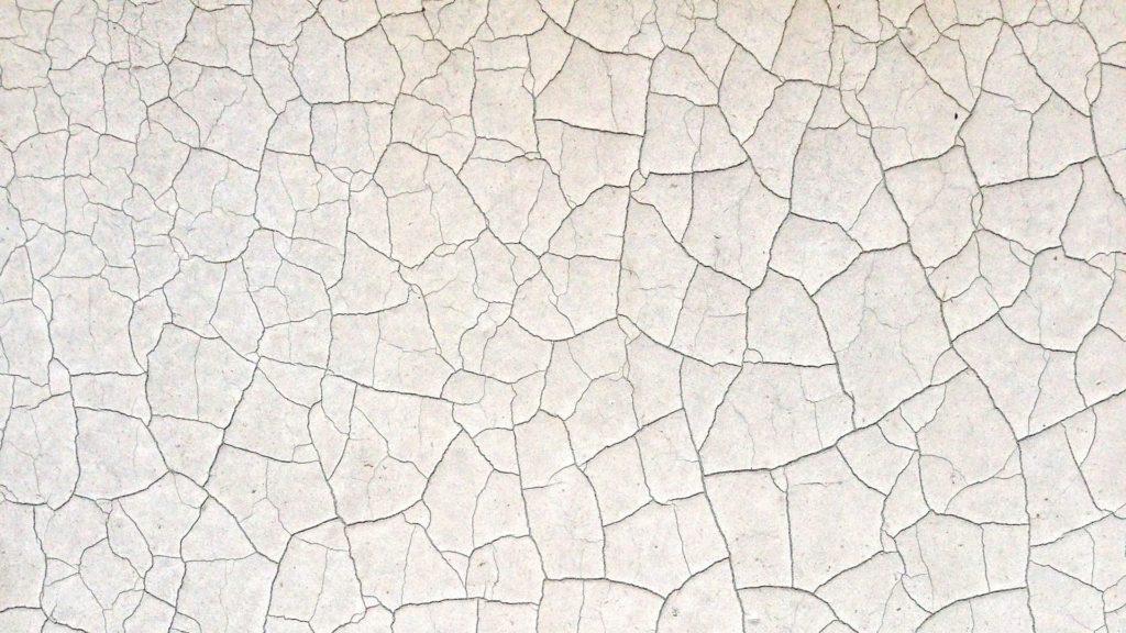 細かいひび割れのある白い壁の無料バーチャル背景素材