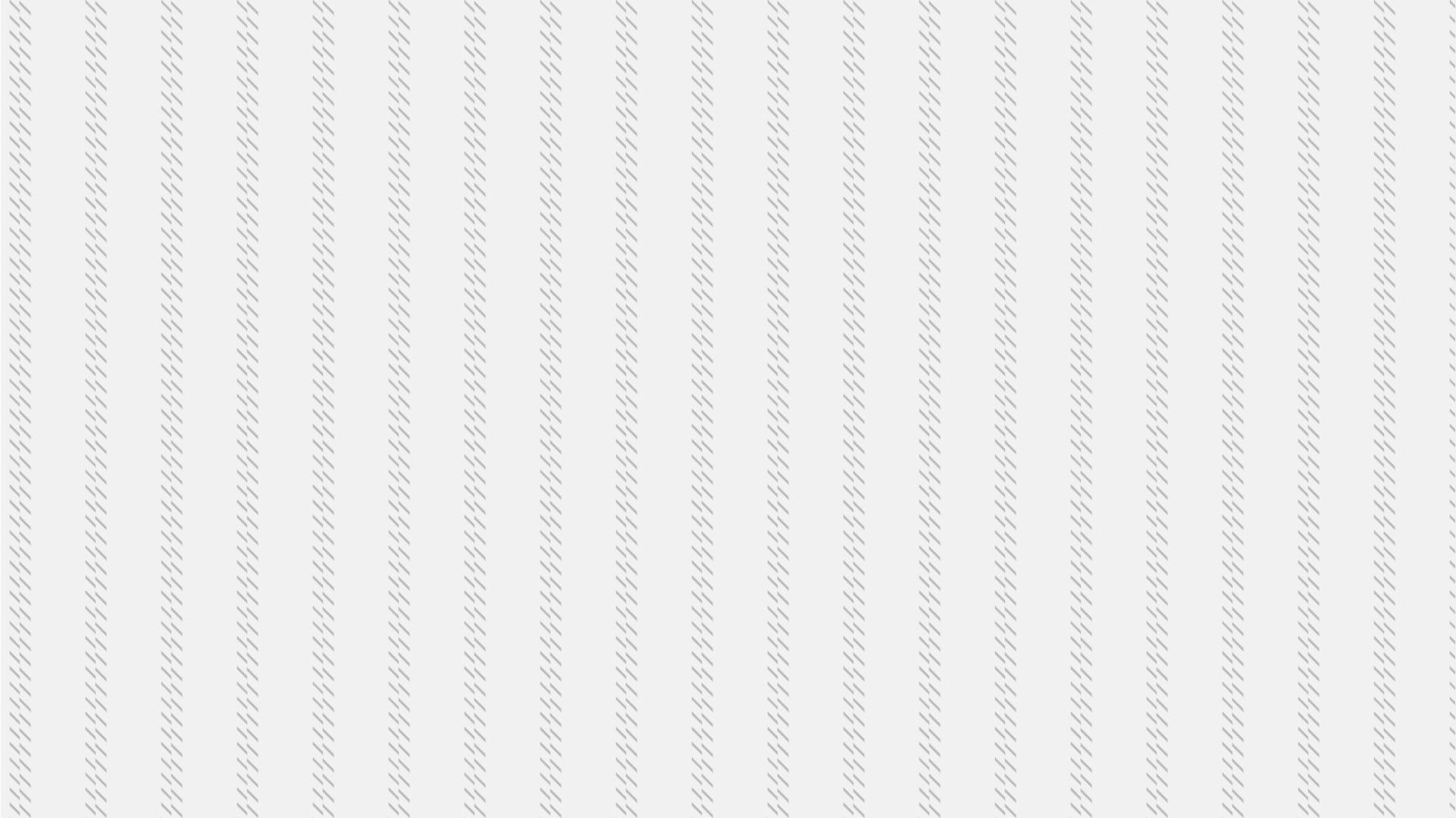 斜めの細かい線の入ったグレーの壁