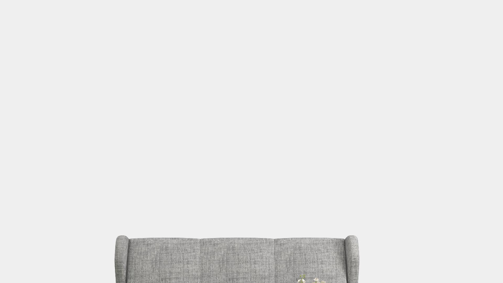 グレーのソファーと白い壁
