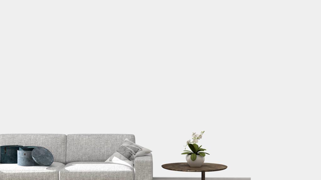 グレーのソファーと小さなテーブルのある部屋
