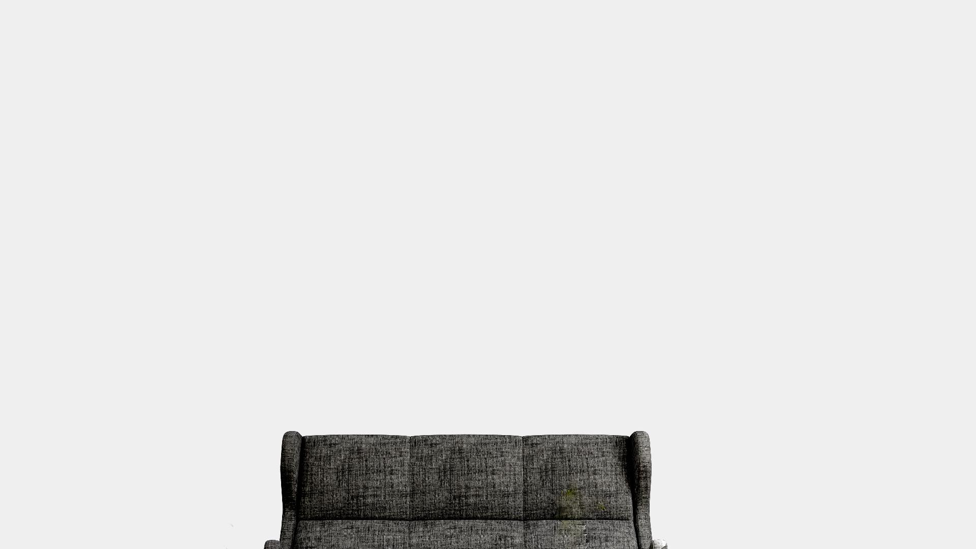 黒いソファーとグレーの壁