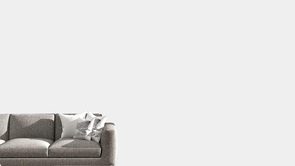 グレーのソファーと白いクッション